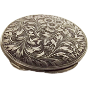 An Italian White Metal Ladies Compact With Floral Decoration