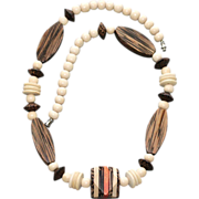Vintage Seventies Exotic Wood Beaded Necklace with Colorful Faceted Focal Bead