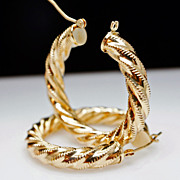Hollow 14k Yellow Gold Twist Hoop Earrings