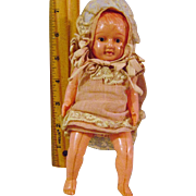 Vintage Seven Inch Celluloid Dressed Doll