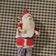 Vintage Santa with a Sack on his Back
