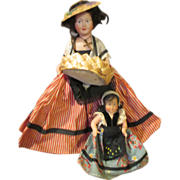 Two French Celluloid Dolls - The Flower Peddler and her daughter