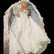 Vintage Tiny Storybook Baby Doll in Cradle