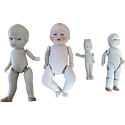Group of 4 All Bisque Dolls
