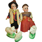 Two Bisque Head Dolls with their Farm Animals