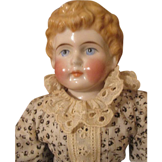 Very Pretty Blond China Head Doll with Unusual Hair Style