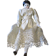 "Sweet 9.5"" China Head Doll in Darling Dress"