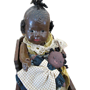 Vintage Black Composition Baby Doll in Wooden Cradle and Black Rag Doll
