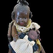 Vintage Black Composition Baby Doll in Wooden Cradle and Black Rag Doll