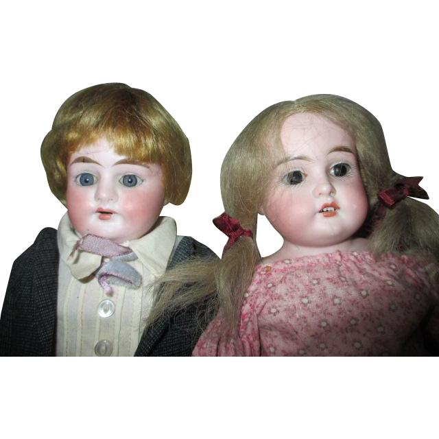 Two Antique Bisque Head Dolls