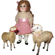 Darling All Bisque Doll with her two lambs