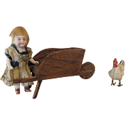 Antique All Bisque Doll with Wooden Wheelbarrow and Chicken
