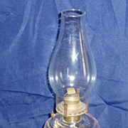 Early 1900,s clear glass oil/kereosene lamp with burner and chimney