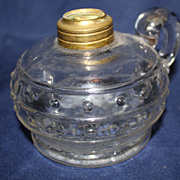 Antique clear glass finger oil lamp