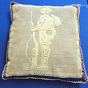 WW1 crochet of Soldier on a silk covered pillow