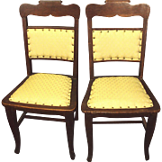 TWO 1800's Chairs, Dark Oak with Carved Scroll Top