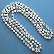 Vintage Double Strand Faux Pearls with Sterling Silver Clasp.