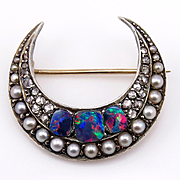 Victorian Silver and Gold Split Pearl, Diamond and Black Opal CRESCENT BROOCH.