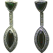 Ladies 18K White Gold Earrings set with 9.86 Carats of Black Opals accented by Diamonds