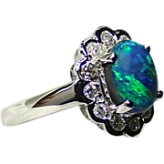 Ladies 18K White Gold Ring featuring a 1.85 Carat Lightning Ridge Opal with Diamonds