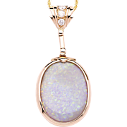 Ladies Unique Australian Opal 18K Yellow Gold Pendant accented with Diamonds