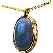 Ladies 18K Yellow Gold Pendant with a 43.34 Carat Solid Lightning Ridge Opal