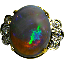 Ladies 8.80 Carat Solid Australian Opal set in 18K Yellow Gold Ring with Diamonds