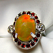 Ladies Solid Crystal Opal 18K White Gold Ring Surrounded by Rubies and Diamonds