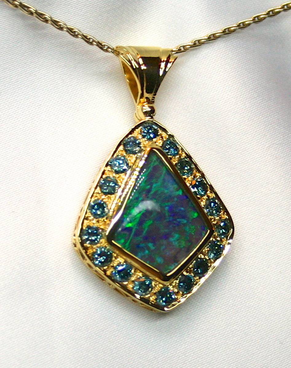 Ladies Lightning Ridge Solid Opal 18K Yellow Gold Pendant with Enhanced Blue Diamonds