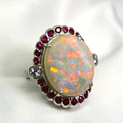 Australian Solid Opal 18K White Gold Ring surrounded with Rubies and Diamonds