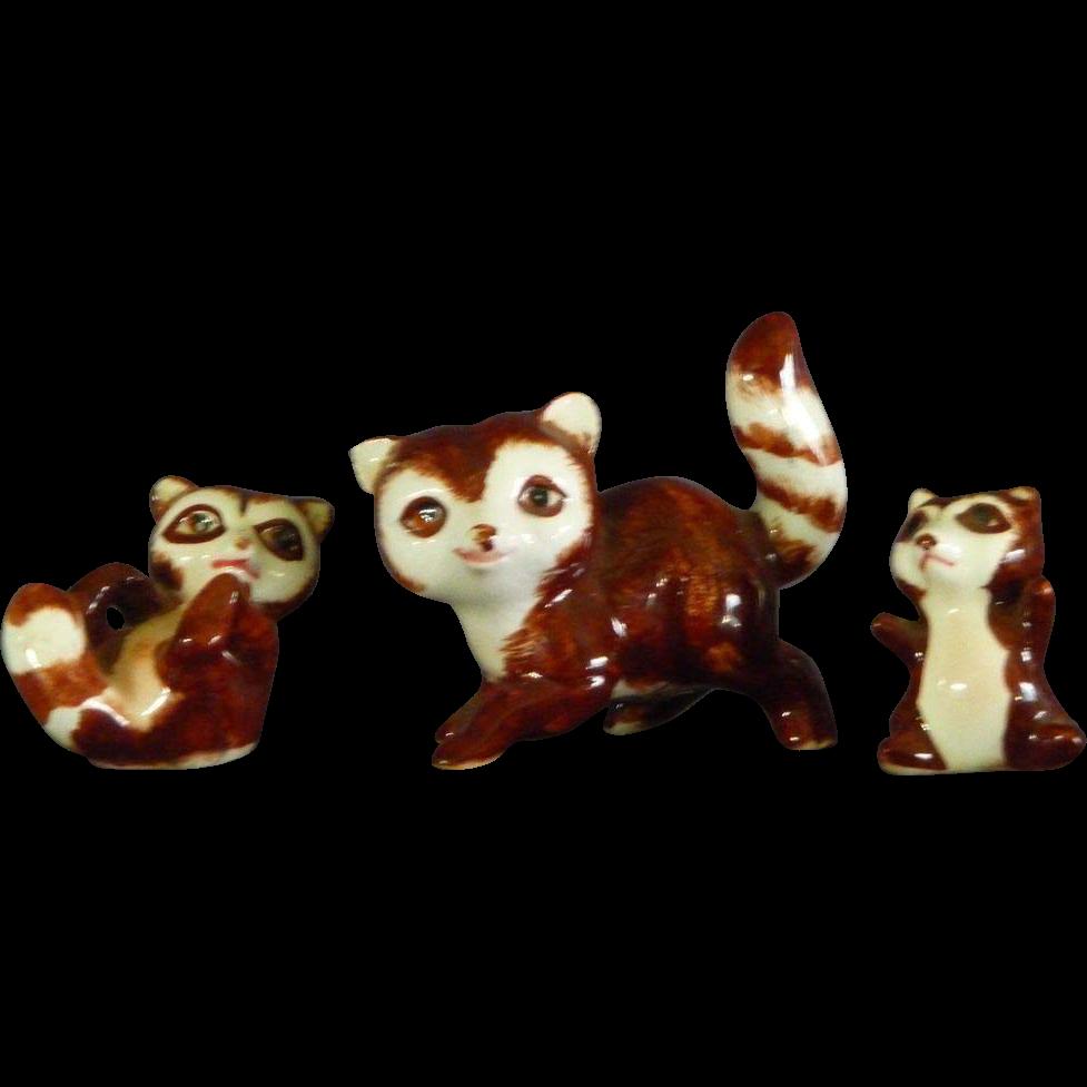 Family of Ceramic Raccoon Figurines