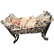 "Tiny 2"" Bisque Baby in Soft Metal Cradle"