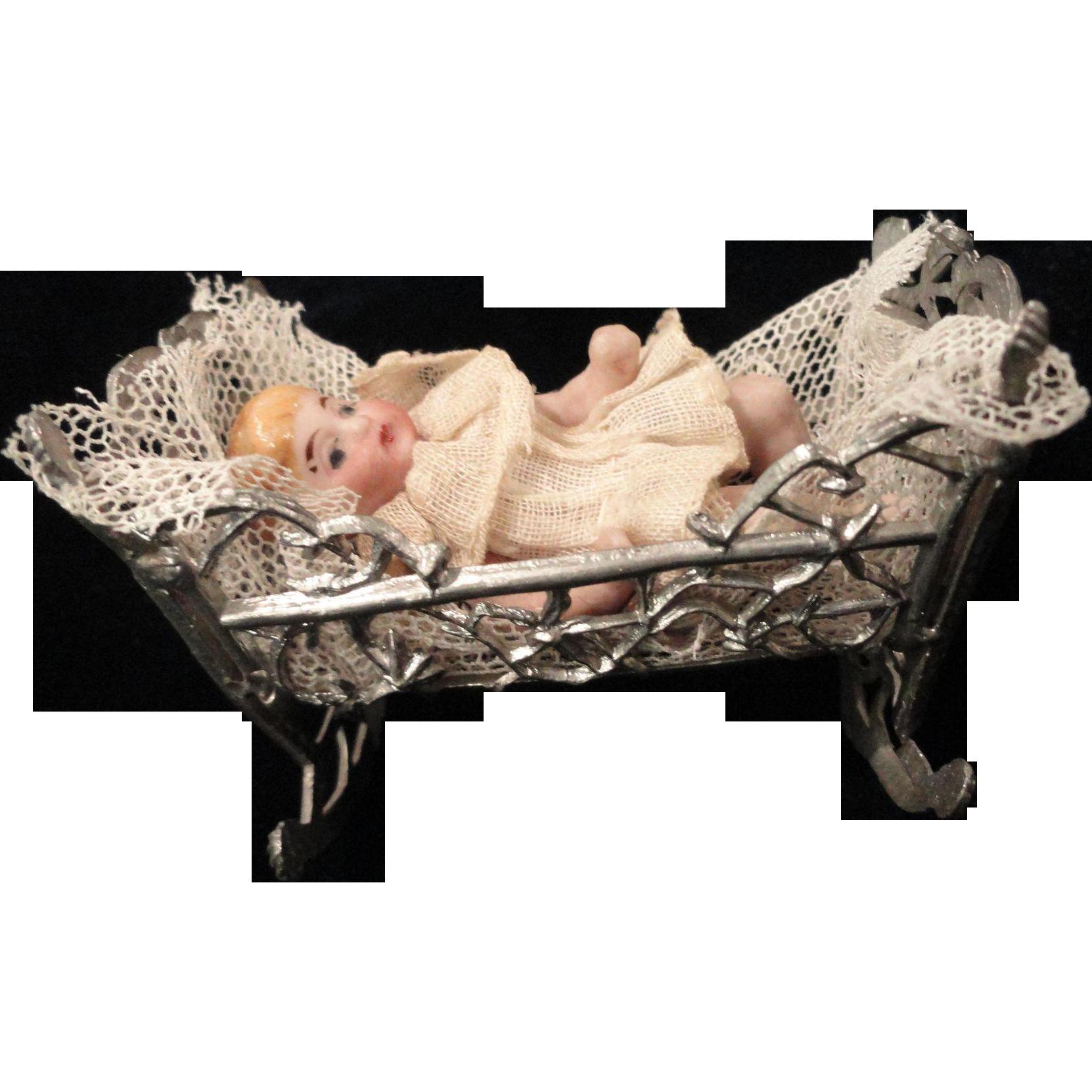 "Tiny 2"" Bisque Baby in Soft Metal Cradle"