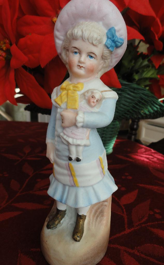 Bisque Figurine of Sweet Girl Holding Her Doll