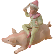 Bisque Figurine Clown on Pig