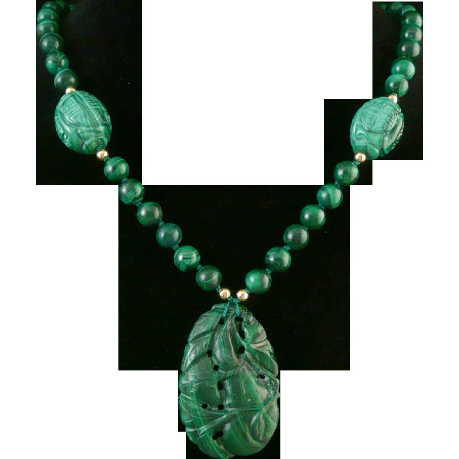 1920s carved malachite pendant on malachite