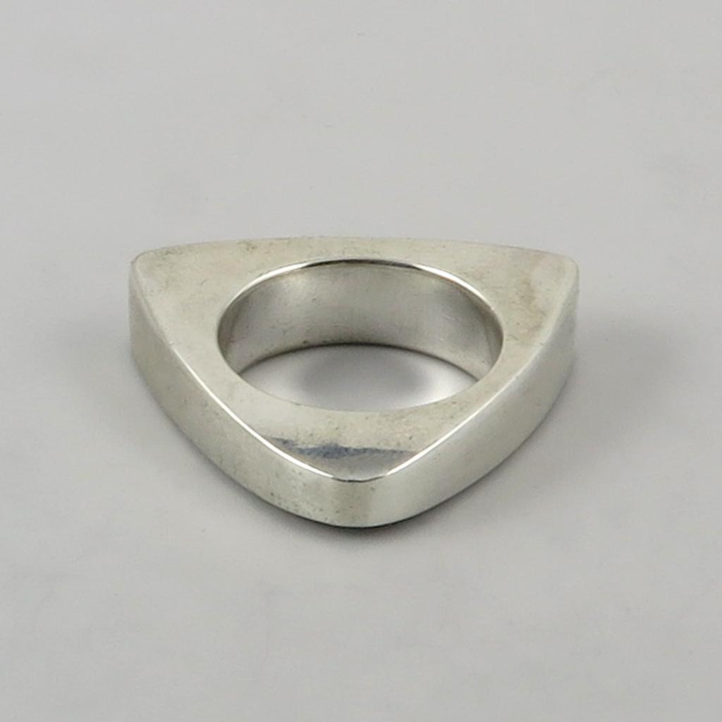 modernist designer solid heavy silver ring or pendant from