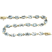 18ctw Sparkling Blue Topaz Tennis Bracelet in 10K Yellow Gold