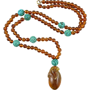 Carved Turquoise and Baltic Cognac Amber Carved Pendant Necklace 27""