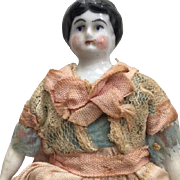 "Delightful 6 1/2"" China Head Doll"