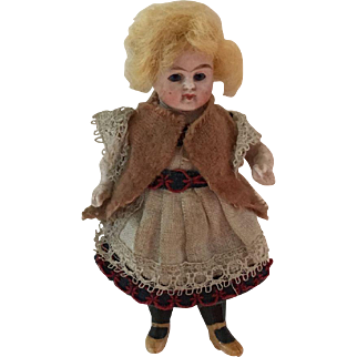 All Bisque Doll with Glass Eyes 3 1/2""