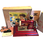 Red Casige Child's Sewing Machine in Box with Original Accessories and Receipt