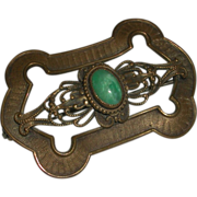 Ornate Brass Sash Pin Brooch Oval Green Cabachon Stone c clasp c. 1890-1910