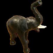"Leather Like Covered Elephant with Upraised Trunk Symbolizing ""Good Luck"""