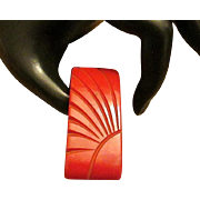 Very Cherry Red Bakelite Clip with Carved Sun Rays