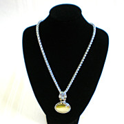 Silvertone and Goldtone Necklace with Bezel Set Pendant