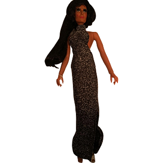 Mint Cher Doll wearing original black gown!