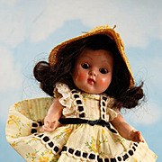 "Rare Brown Eyes:1953 Ginny "" Wanda"" #40 Tiny Miss series, wearing white cotton dress with yellow flower print and tibbon claced trim and gathered eyelet on sleeves. Yellow straw hat with"