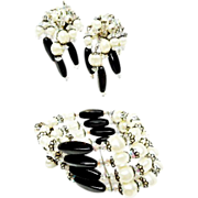 Dazzling Hobe Spring coil bracelet and Long Cha Cha Earrings