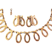 Renoir Modernist script necklace earring set